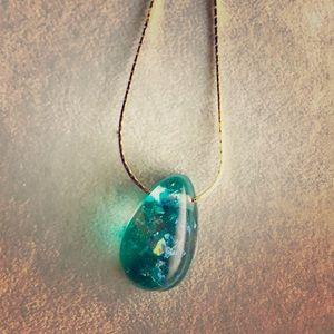 Green iridescent teardrop resin necklace